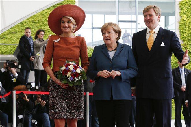 Guillermo y Máxima con Merkel