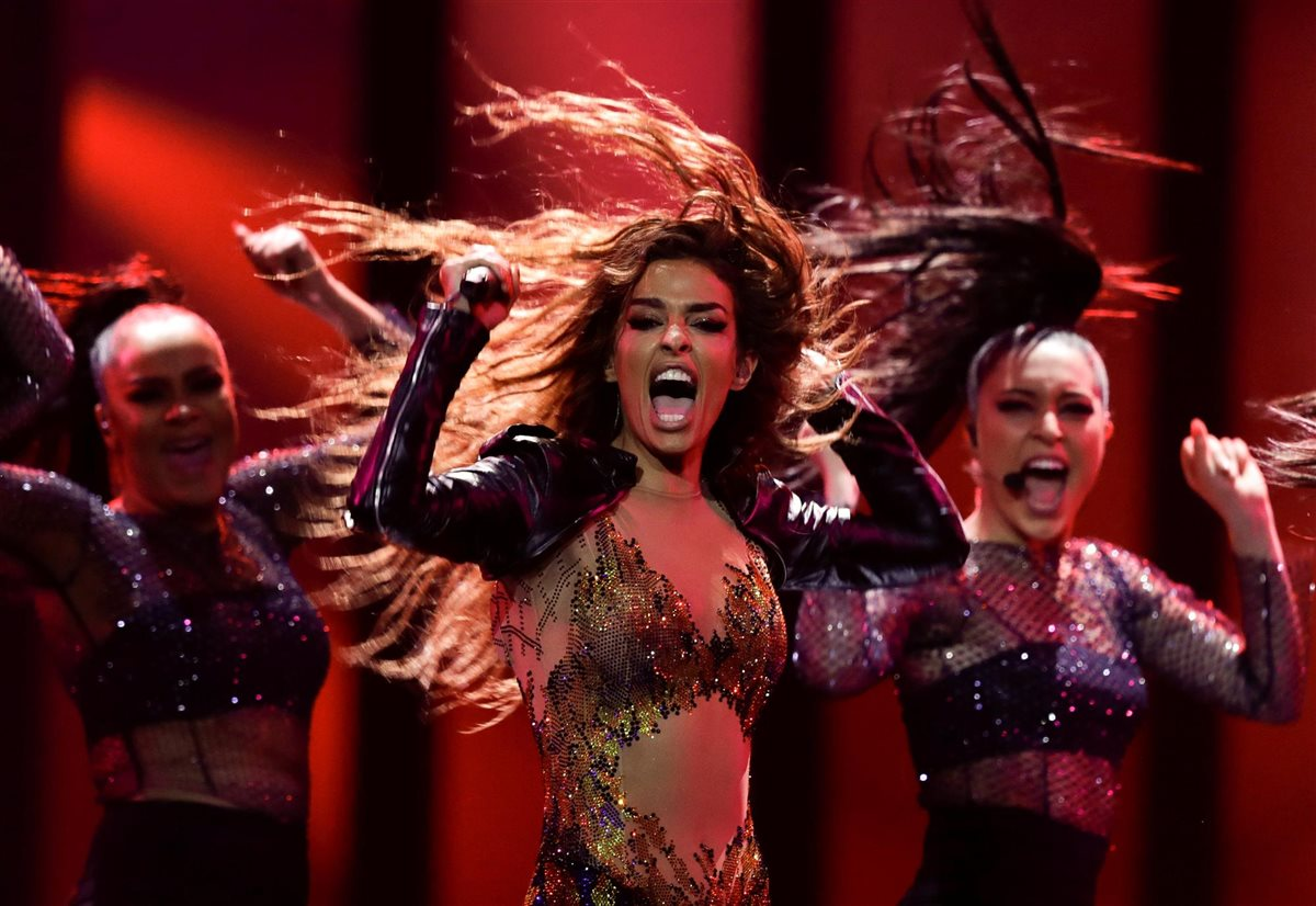 Hip-hop dancers in sequins with long hair flying in wind